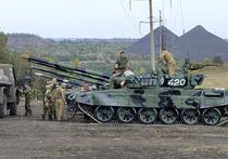 Киев: отвод вооружений приближает конец войны на Донбассе