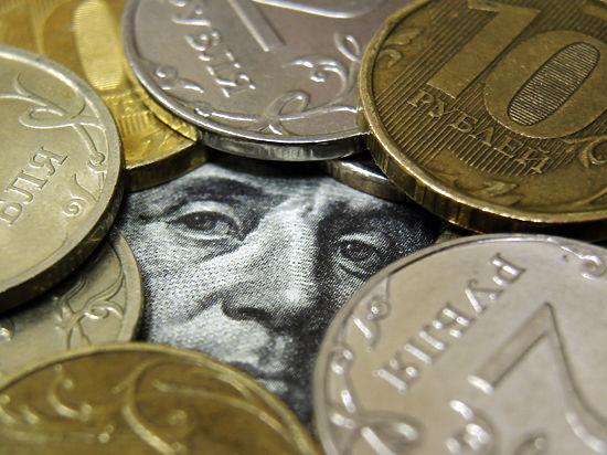 К Новому году рубль отберет у доллара последние центы
