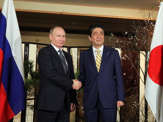 Визит Путина в Японию начался со встречи в купальне