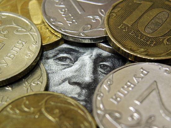 Национальная валюта стала стоить больше 60 рублей за доллар