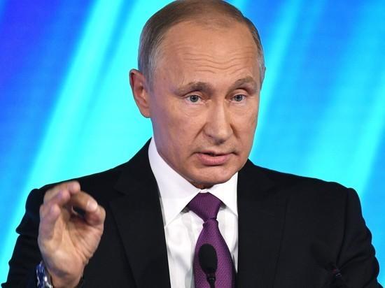 Путин разрешил ущипнуть себя темнокожему студенту