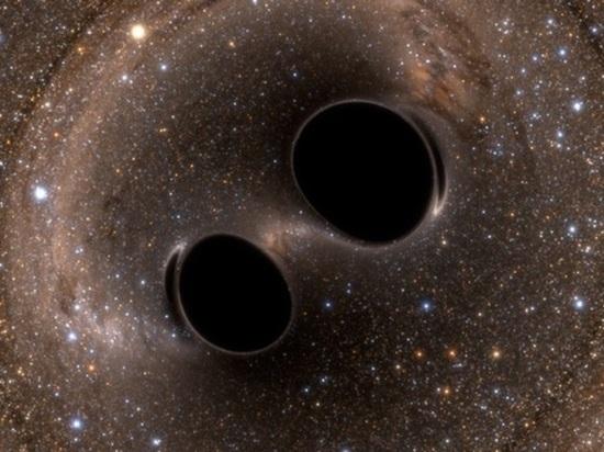 Обнаружена пара черных дыр, готовых встряхнуть пространство и время