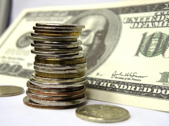 Будущее российской валюты определят нефть, санкции и выборы президента