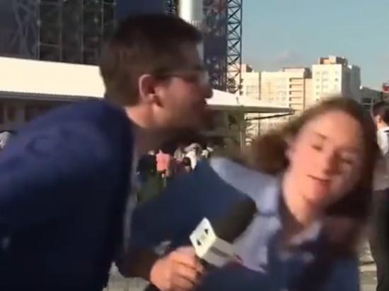 Журналистка увернулась от любвеобильного российского фаната в прямом эфире