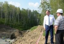Бурков поручил новому министру строительства Заеву восстановить смытую дорогу за 2 недели