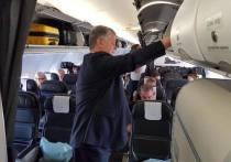 Президента Украины Петра Порошенко заметили на борту рейсового самолета авиакомпании British Airways – политик возвращался в Киев из Лондона