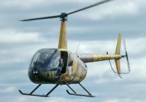 Пилоту частного вертолета Robinson, который рухнул в горах Якутии, удалось выжить после четырех дней пребывания в ущелье при минусовой температуре