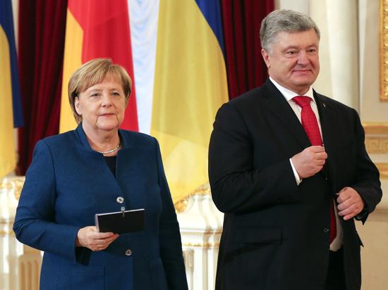 Меркель в Киеве заговорила по-украински и пообещала продлить санкции