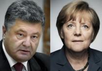 Порошенко попросил у Меркель санкций для России из-за паспортов