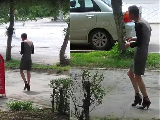 В Магнитогорске мужчина гуляет по улице в платье и с утюгом