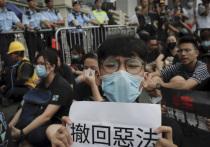 В воскресенье Гонконге примерно два миллиона человек вышли на улицы, выступая против изменения законов об экстрадиции и фактически отстаивая принцип «одна страна, две системы»