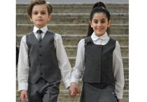 Милонов потребовал одеть школьников в картузы и передники