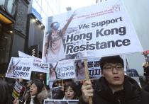 Массовые протесты разделили многих жителей Гонконга на два лагеря — оппозиционеров и полицейских