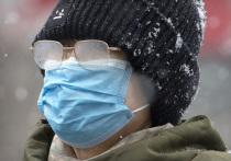 Смерть от коронавируса пересекла границы Китая: что известно об умершем