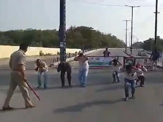 Как полиция борется с нарушителями карантина: палки, краска на лбу, дроны