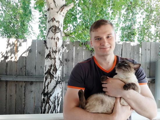 Глава Хакасии сфотографировался со своим котом