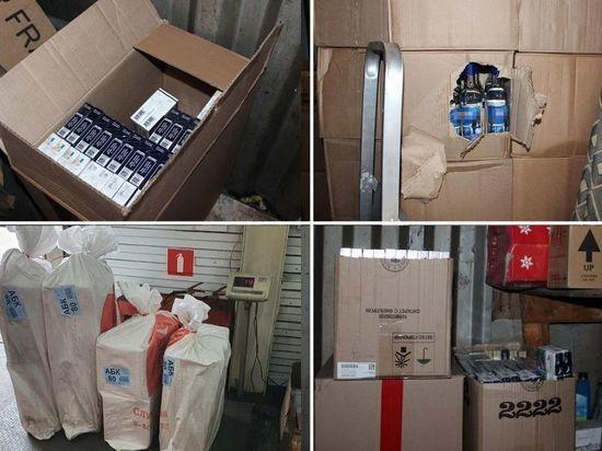 У жителя Хакасии в 2 гаражах хранилась крупная партия нелегальной продукции