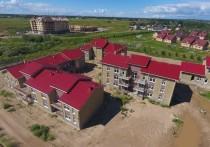 Строительство «многострадального» социального городка (таким эпитетом объект наградила председатель комитета по соцзащите) возобновилось в Борисовичах