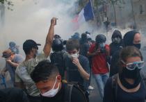 Более 250 человек были задержаны в Париже в ходе столкновений с полицией, разгоревшихся во время субботней акции «желтых жилетов» – первой за последние месяцы