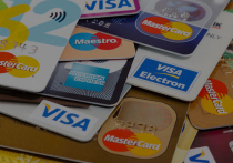 Германия: Банки ввели комиссии за безналичные оплаты по карте