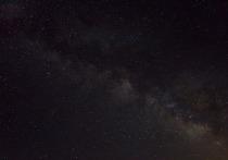 Галактика Млечный Путь начала менять форму в результате столкновения со своим спутником