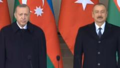Лица Эрдогана и Алиева на параде в Баку: странные кадры