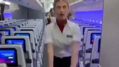 Стюардесса покорила соцсети эффектным сальто на борту