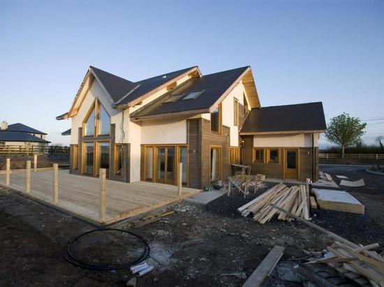 Омичи смогут взять ипотеку на деревянные дома