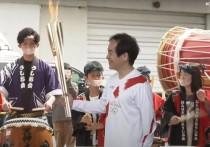 C территории футбольного тренировочного центра J-Village в японской префектуре Фукусима стартовала эстафета олимпийского огня в четверг, 25 марта