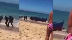 Спешная высадка африканских мигрантов на итальянский пляж попала на видео