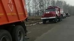 Ликвидация пожара на свалке в Тисульском районе