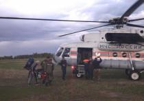 В Якутии тушат лесной пожар в 900 метрах от села Тюбяй