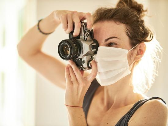 Германия: Защитные маски еще долго будут частью нашей жизни
