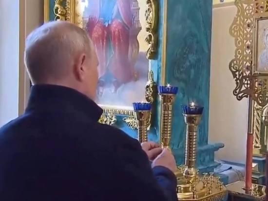 Путин поставил свечку в Коневском монастыре на Ладоге