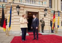 Меркель назвала Россию участницей войны на Донбассе и пригрозила санкциями