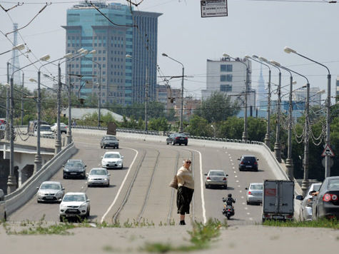 215 километров дорог покроют Москву затри года