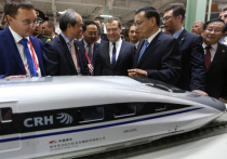 Медведев и игрушечный паровозик: китайцы исполнили детскую мечту премьера