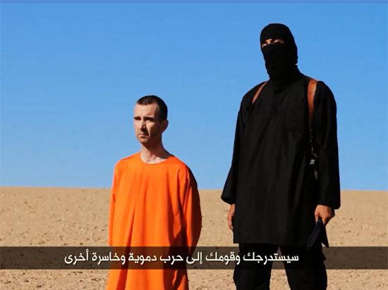 Боевики ИГ казнили Дэвида Хэйнса и заявили, что вскоре казнят четвертого заложника Алана Хеннинга
