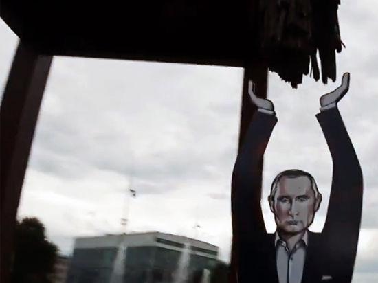 Трехметровый Путин-миротворец поддержал
